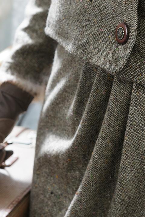 ASITA SAHABI brown tweed costume with fur trim and draping