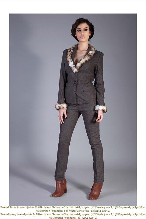 Brown tweed pantsuit with fur trim and rhinestone cuff
