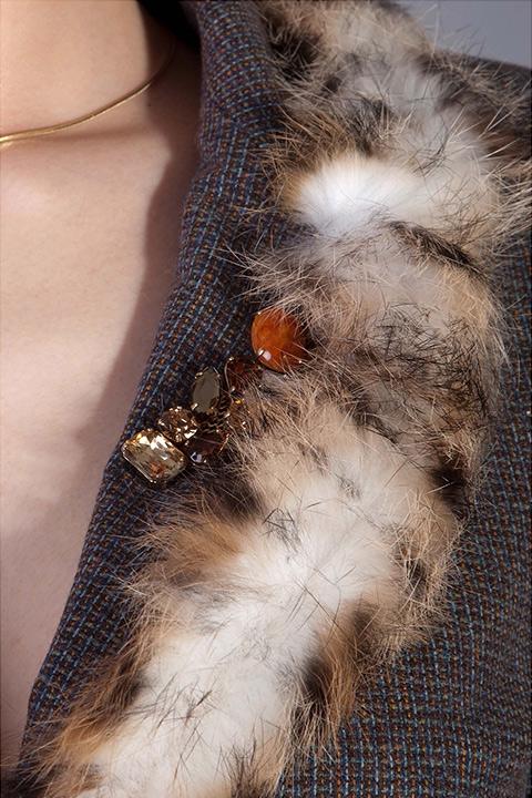 brown tweed blazer with fur trim and rhinestone brooch
