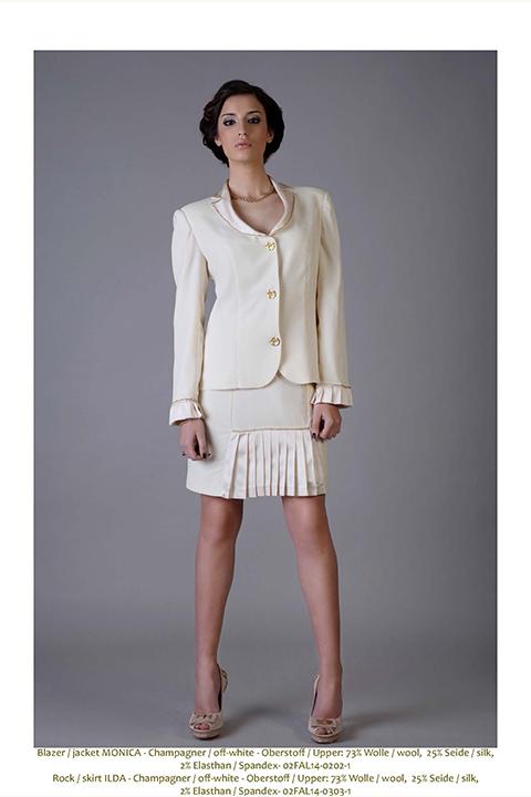ASITA SAHABI ivory wool blend costume with plissé