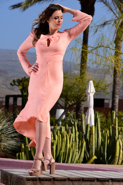 coral colored silk dress in midi length