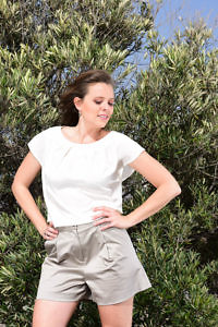 ivory silk blouse and khaki cotton shorts